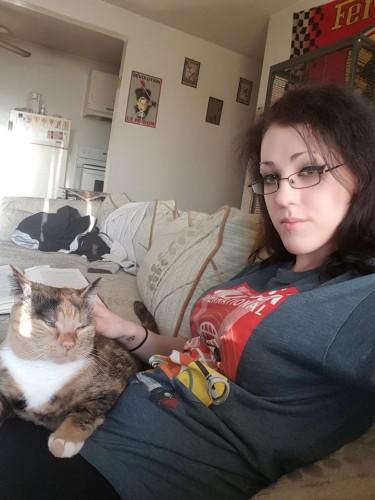 Fat cat keeping the kiddo warm.